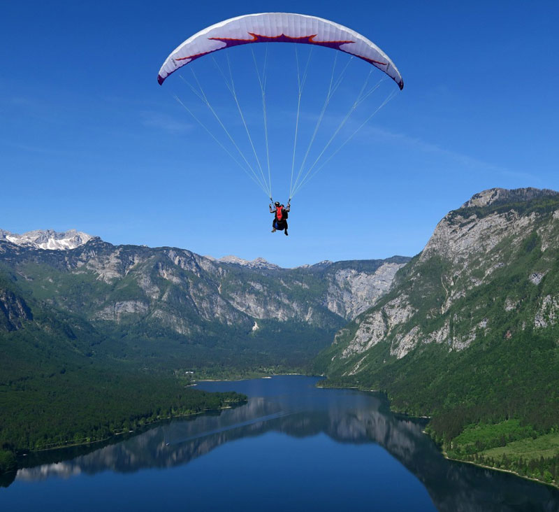 A paraglider is a lightweight, free-flying, foot-launched glider aircraft with no rigid primary structure